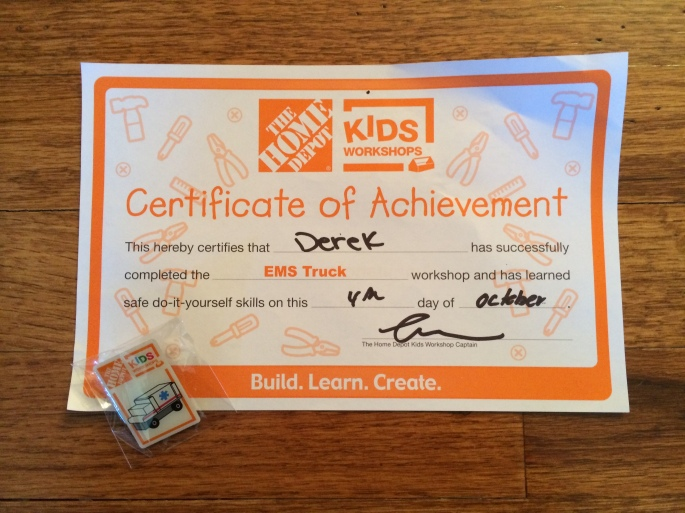 Certificate and pin from Home Depot. The pin is supposed to be put on the apron they give each kid.