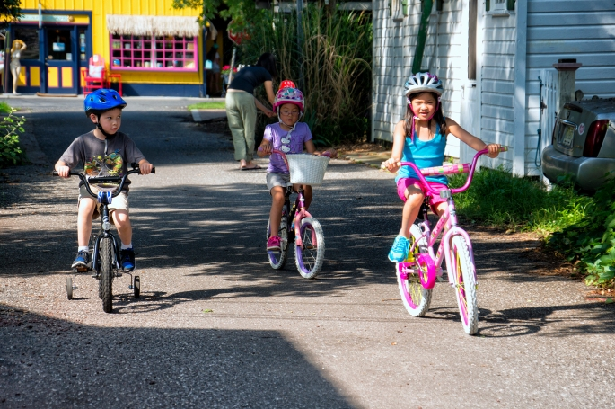 It's nice that the kids can ride their bikes in the street because it's not too crowded.