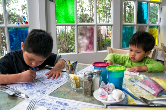 The kids color their placemats while waiting for breakfast to be served at The Mad Batter.